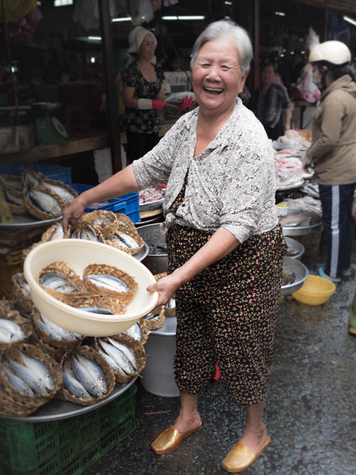 Lady showing fish at market