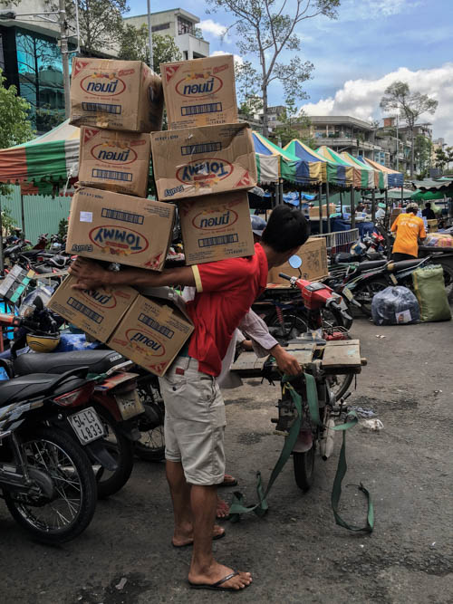 Some impressive box carrying skills at Binh Tay Market.