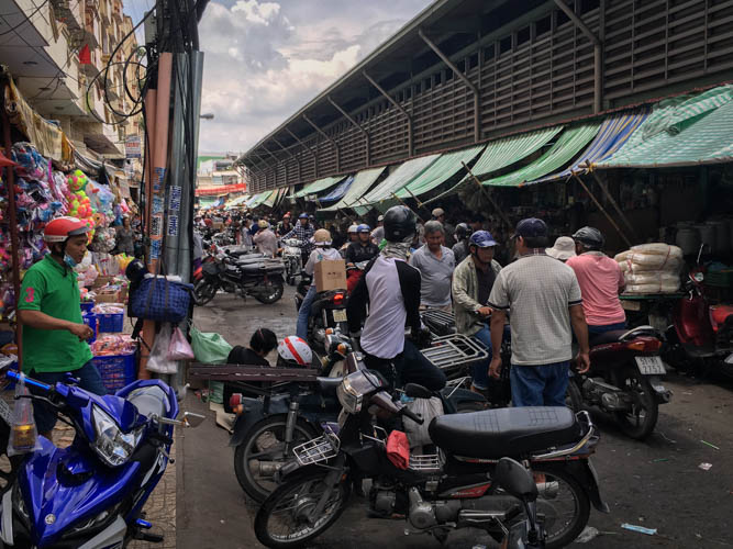 Organised chaos of motorbikes at Binh Tay Market