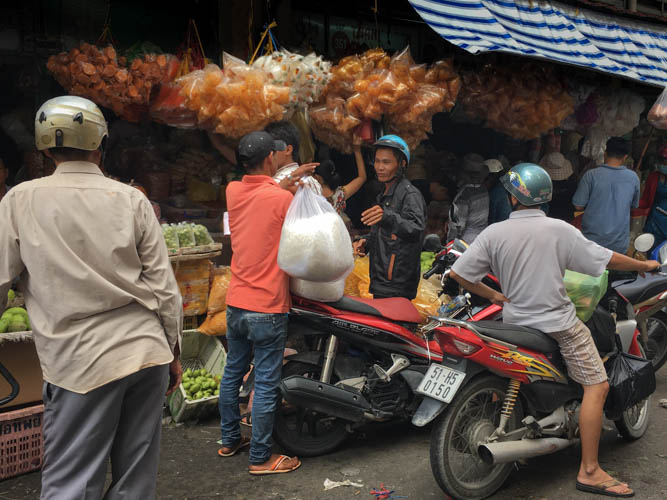 Collecting an order at Binh Tay Market