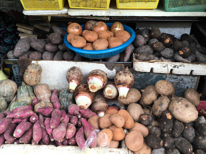 Various vegetables on display at Ben Thanh market during a guided tour by Vietnam Cookery Centre